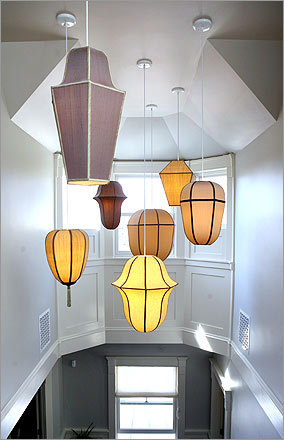 The lighting fixtures feature energy-efficient light bulbs.