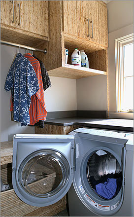 Goldman's laundry room has shelving made of recycled boards and her Bosch washing machine, depending on the load, can use a mere two gallons of water. Her pipes are cast iron, not plastic.