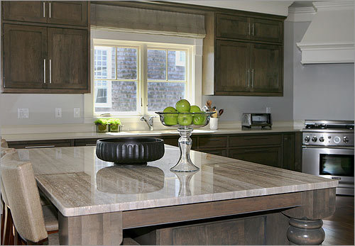 The island in the kitchen is made of stone in the Goldman's green home. Her kitchen counter consists of Silestone.