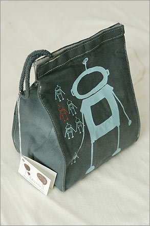 A lunch box from the eco-clothing line, Toby + Rei, shows the robot designs that make the brand popular.