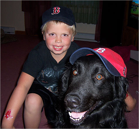 In Dale's house in South Gibson, Penn., there's a divide among Phillies and Red Sox fans. 'My son Ryan couldn't convert his brother or me so our dog Max cheers for the Sox with him,' Dale writes.