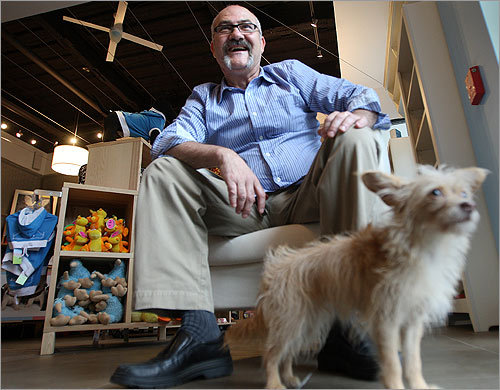 Dog toys, beauty treatments, dog pillows, dog beds, and even a spa collection abound at the new boutique for pets called Espeso on Washington Street in the South End. Owner Jose Estrela poses with Lola, an 18-month-old Chihuahua and Poodle mix which belongs to his store manager.