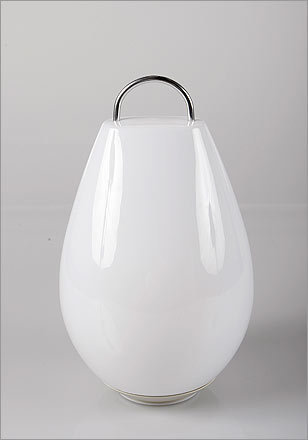 Luau Portable Lamp , $199, from Vessel, vessel.com You never know when the patio party will move to the beach or into the woods to catch fireflies. Charge this lantern and take it wherever the night leads. Adjust the lamp's levels for instant mood lighting.