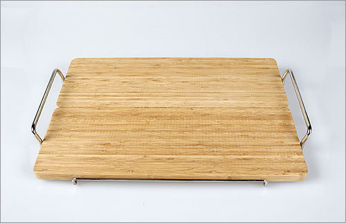 Chop Chop Tray , $80, from Vessel, vessel.com Need four more hands to get multiple appetizers and platters out the door? Problem solved. Chop all your veggies and cheese on this board, carry outside, and lift the bamboo trays off the frame to serve different groups of guests.