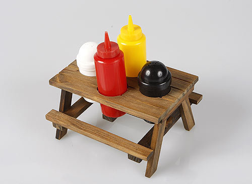 Décor Craft Inc. Picnic Table Condiment Set , $18, from Davis Squared, davissquared.com Use this twee ketchup-and-mustard caddy to keep your toppings together. Bonus: Can also double as Malibu Barbie furniture. Ken makes a mean burger.