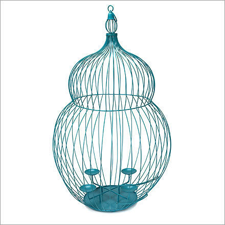 Blue Wire Birdcage , $175, from Conran Shop, conranusa.com Paper lanterns are nice, but so overdone. Mix up your patio lighting with a flock of these birdcage votive holders and wait for compliments. Also comes in orange ($150) and green ($95).