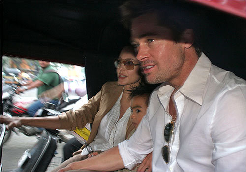 Children of stars, in this case Angelina Jolie and Brad Pitt's son, Maddox, occasionally wear the fauxhawk. Here, the trio sat in an auto-rickshaw as they went out for a ride in Pune, southeast of Mumbai, India in October 2006.