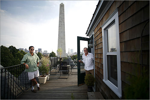 A close look at Boston's high-rise hideaways discloses the truth: city dwellers find peace and solitude — not to mention spectacular views — far above the concrete jungle. Whether it's morning coffee or cocktails or a midnight read, those lucky enough to have roof deck access can escape their four walls and live an open-air life here in the summer. Duncan Donahue (left) and Tom Fortier's rooftop deck on Monument Square in Charlestown has views of Bunker Hill, the Bunker Hill Monument, and the Tobin Bridge.