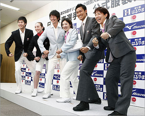 Limited time offer Is the Japanese team in Beijing to compete in the games, or sell time shares? Nothing says 'I'm an enthusiastic seller' like sparkling white shoes, powder blue blazers, and those very unfortunate trouser-shorts (second from left).