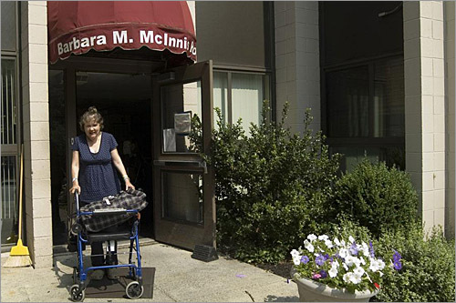Joanne leaves the McInnis House with what she calls her 'sweet ride' - a blue rolling walker.
