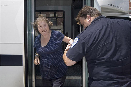 Joanne gets a helping hand after the medical van arrives at the new location. The Barbara McInnis House is the primary referral source for Boston Hospitals when they discharge homeless people who need sub-acute care for complex medical or psychiatric conditions. Joanne, who was referred because of an infected wound on her leg, had been a patient at McInnis House for three months prior to the move.