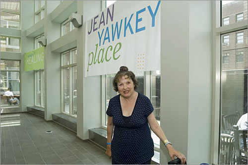 Inside Jean Yawkey Place, Joanne is immediately impressed by the soaring atrium and outdoor deck. The new facility also has a recreation room with a large pool table, flat screen TV, books, and games.