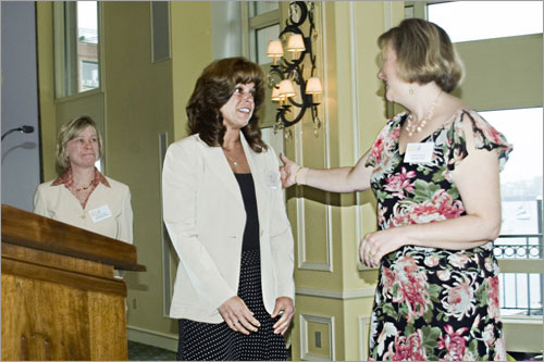 Kathleen Janiak, daughter of nominator Joan Barbary, greets Teresa Colacitti.