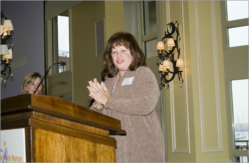 Honoree Janice Tully accepts her award.
