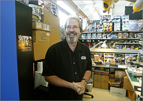 Hasbro senior toy designer Mark Boudreaux in his crowded office at the toy company in Pawtucket, R.I. He has designed many Star Wars action figures and toys.