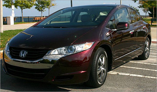 The FCX Clarity was 'just another car' parked along the waterfront in South Boston until one driver -- in a Honda Civic -- stopped and asked, 'Is it a new hybrid?'