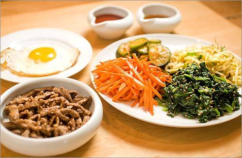 1. To make dolsot bibimbap, or stone pot bibimbap, use cooked rice, seasoned vegetables, beef, and a fried egg. A well-seasoned bowl ($25 at Korean markets) produces a crisp, crunchy bottom. So does a cast-iron or another heavy skillet.