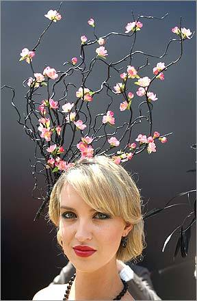 A race-goer prepares for judging for the Fashion in the Field competition before Australia's biggest horse race, the Melbourne Cup, on November 4. The race is enticing more overseas riders for the $3.6 million US dollars in prize money.