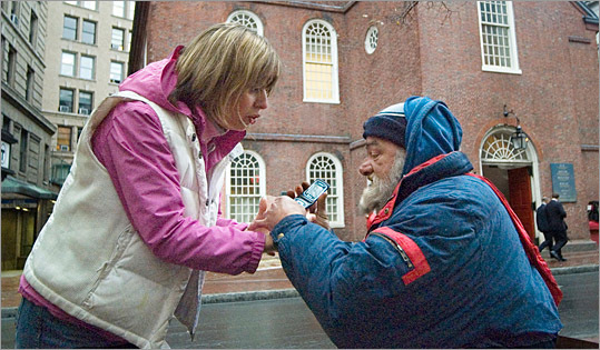 Denise Petrella, RN, CS, ANP, of Boston Health Care for the Homeless Program's Street Team tries to help her client Bob procure a spot at a detox center.