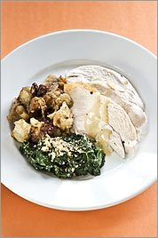 A full plate of turkey, stuffing made with fennel, onions, dried apples and cherries, and a gratin of spinach and Swiss chard.