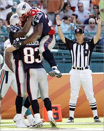 New England Patriots' Randy Moss (left), Sammy Ross, and Wes Welker celebrated after Moss scored a touchdown in the second quarter.