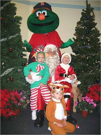 You better not cry! Sure, Santa can be a scary guy. But he can be fun, too. Three-year-old triplets Jordan, Keith, and Cam of Ipswich spend a Red Sox Christmas with Santa and Wally. Check out these varying responses with the Man in Red and send us your photos with Santa !