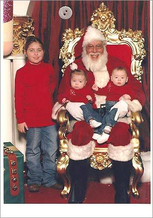 Jaden, 7, and sisters, Ava and Peyton, 7 months, visit Santa at Square One Mall in Saugus. 'Jaden was just happy she didn't have to sit with Santa alone anymore,' writes Jill.