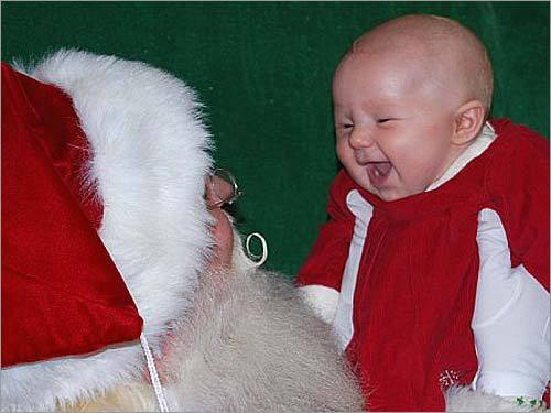 Santa from the Solomon Pond Mall made a good impression on 3-month-old Parker last year. The parents are hoping for similar luck. 'Parker loved Santa and gave him the biggest smiles! We hope to get the same reaction this year,' writes Michelle, of Clinton.
