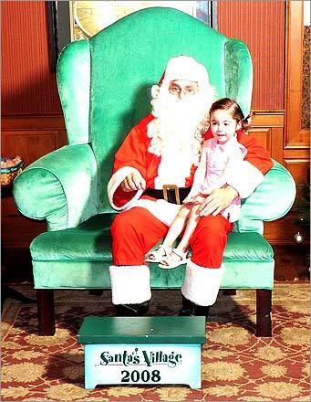 Santa and Shea spend a moment at Santa's Village.