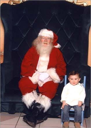 Alexandra, 19 months, refused to sit on the big guy's lap, but she was 'willing to do her own thing,' write her parents.