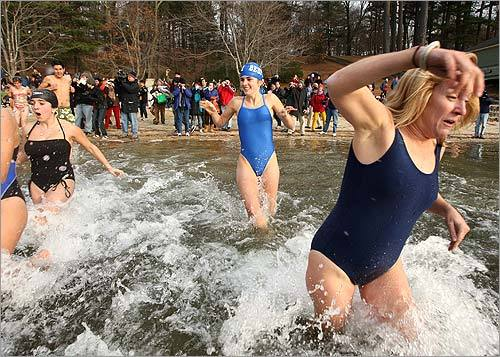 Marina Tomao, 17, of Bedford High School who came with about seven more members of the school's swimming team, and Carol Band, right, of Arlington, who came with the Bratlett Babes of Arlington, were among those who took the frigid plunge.