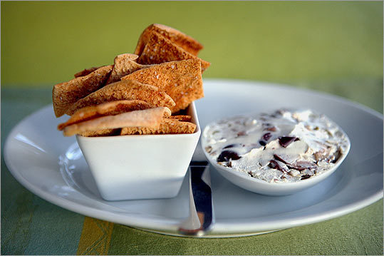 Crisp rectangles accompany a creamy dip made with olives.