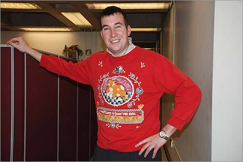 John of Charlestown shows his holiday cheer, despite taunts from his friend, Eileen O'Connor. 'I think his sweater is getting small,' she writes.