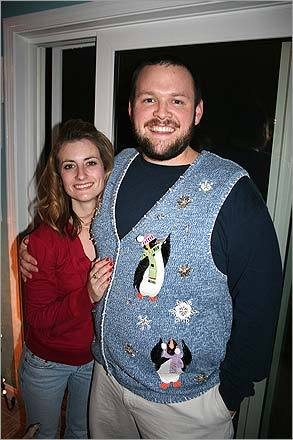 Sky Souza and her boyfriend. Erik Croswell, both of Amherst, N.H., smile big in their holiday sweaters.