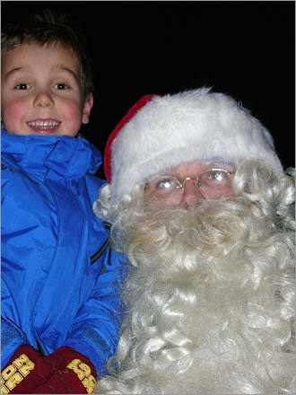 Andrew, 5, lights up when he sees Santa at Andover's tree lighting on Dec. 5, 2008.