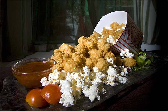 Nuggets of popcorn shrimp come in a movie-style popcorn box.