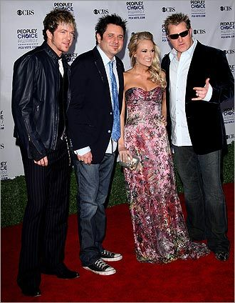 Jay DeMarcus, Joe Don Rooney and Gary LeVox of Rascal Flatts with Carrie Underwood