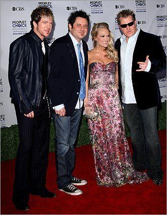Jay DeMarcus, Joe Don Rooney and Gary LeVox of Rascal Flatts with Carrie Underwood