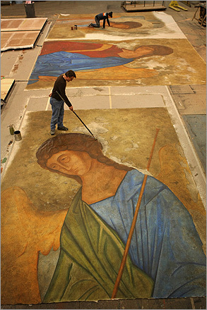 THE MURAL Scenic artist Jerry Vogt works on a 20-foot by 18-foot mural to be used for the set.