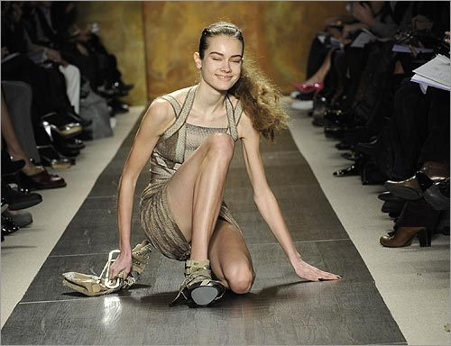 Crash and burn: A model slips during the fall 2009 collection of Herve Leger.
