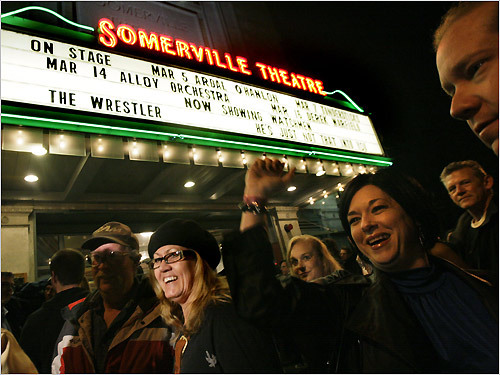 A wristband, like the one this concert goer is wearing, was required to enter the Somerville Theatre