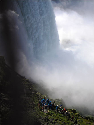At Niagara Falls. Steve said, 'The people in the photo are part of a group tour that is taken down an elevator and brought out underneath the Falls.'