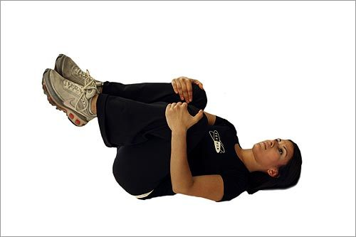 Cool-down 3: Knees to chest stretch. Lie on your back and bring both knees up to your chest. Hold with your hands. Hold for 20 seconds and relax. Repeat 2-3 times.