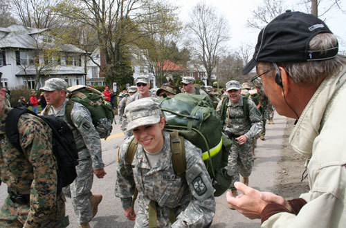Army soldiers marched the entire route in combat boots, with loaded packs on their backs