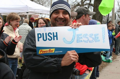 John Flores, 43, of Anchorage cheers for his brother Jesse, 44, running for Team Livestrong in support of their mother, who has a brain tumor.