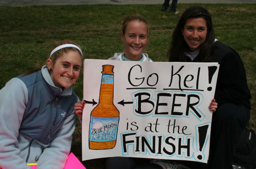 Sam Klym, Kelly Pfeiffer, and Lauren Salvatore, all from Mount Laurel, N.J., cheer for Sam's mom Kelly Klym.