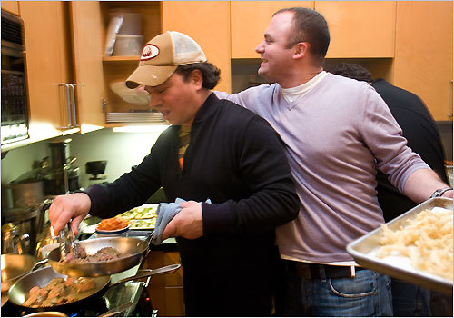Dante de Magistris, chef of Dante in Cambridge (right), in his North End condo with chef Marc Orfaly, a colleague from Pigalle in the Theatre District. It&#146;s just another Sunday evening for these chefs, who are doing what they often do: cooking for each other and hanging out. Read more from The Boston Globe (April 22)