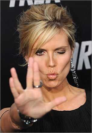 1. Use the Vulcan hand signal Trekkies must be getting cool if even Heidi Klum is flashing the Vulcan symbol. Synonymous with Trekkies (and also featured on the cover of the documentary of the same title), this is a good first step when greeting fellow fans — especially if you add 'live long and prosper.' It's the sci-fi version of the universal peace sign.