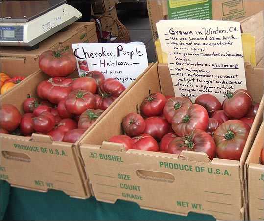 At the Ferry Plaza Farmers Market, these Cherokee purple heirloom tomatoes have been vine-ripened in greenhouses.