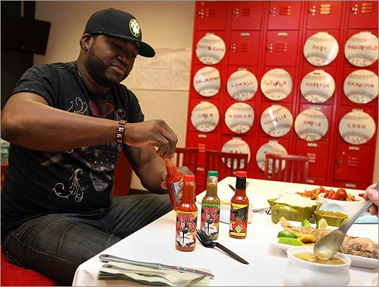 Sox slugger David Ortiz checks out the four different hot sauces sold under the Big Papi name. The hotness level runs from mild (Original En Fuego) to fiery (Grand Slam En Fuego).